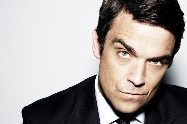Robbie Williams Predicts 'Hard Times' For Justin Bieber